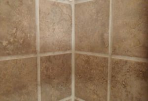 grout on bathroom tile walls