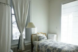 curtain and bed in bedrrom